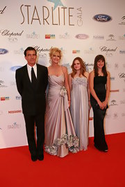 Stella del Carmen looked enchanting at the Starlite Gala in a gray strapless gown with a rose-appliqued bodice.