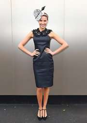 Rachael accessorized her darkly chic sheath dress with T-strap black pumps.