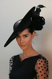 Lindy Klim donned a dramatic tilted black Derby hat for Victoria Day.