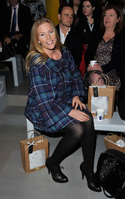 Autumn Phillips looked great in a blue and purple plaid long-sleeve dress at London Fashion Week.