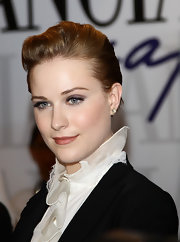 Evan Rachel Wood demonstrates the adaptability of a short cut. At the 68th Venice Film Festival, her hair is combed back and voluminous in the front. A product like Alterna Bamboo Styling Lotion takes care of any frizz and keeps her locks looking lustrous.