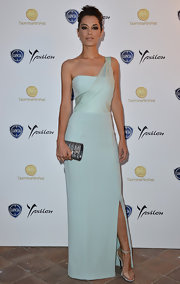 Giorgia Surina looked elegant and ethereal in a soft teal one-shoulder dress.