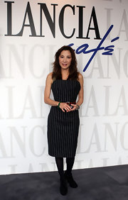 Michelle Yeoh wore a pinstripe dress to the Lancia Cafe in Rome for the Rome Film Festival.