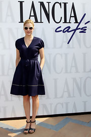 Greta Gerwig opted for casual footwear with these comfy-looking black platform sandals.