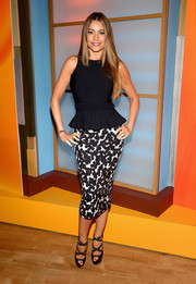 Sofia Vergara visited 'Despierta America' wearing an elegant black peplum top by Alexander McQueen.