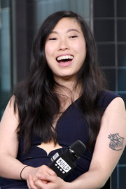 Awkwafina showed off her tiger tattoo when she wore this sleeveless outfit while visiting Build.