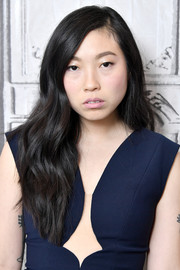 Awkwafina wore her hair down in a gently wavy style while visiting Build.