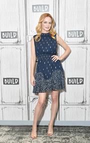 Heather Graham kept it breezy yet elegant in a sleeveless navy dress with gold embroidery while visiting Build.