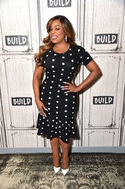 Niecy Nash played up her voluptuous figure in a body-con polka-dot dress during her visit to Build.