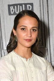Alicia Vikander looked youthful wearing this half-up style while visiting Build.