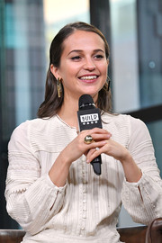 Alicia Vikander accessorized with a chunky gold ring for her visit to Build.