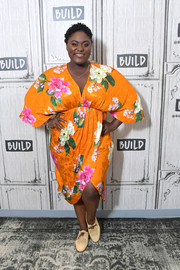 Danielle Brooks was tropical-chic in an orange floral dress with a wraparound skirt while visiting Build.