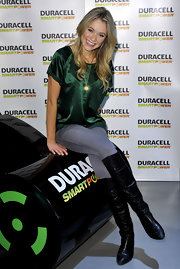 Katrina wears black knee-high boots over her skinny jeans to promote the Duracell Smart Power Lab.