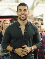 Wilmer Valderrama was spotted at the taping of 'Extra' wearing a black button-down shirt with a mandarin collar.