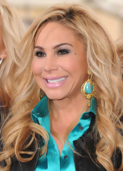 Adrienne Maloof wore an eye-catching pair of dangling turquoise earrings when she appeared on 'Extra.'