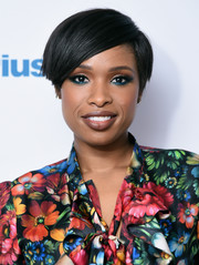 Jennifer Hudson visited SiriusXM rocking heavy eye makeup in a combination of blue and neutrals.