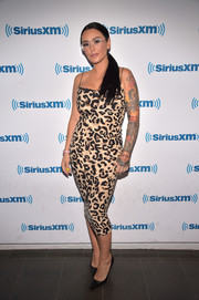 Jenni Farley showed off her figure in a body-con leopard-print dress while visiting SiriusXM.