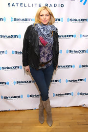 Laura Prepon opted for skinny jeans paired with taupe suede knee-high boots.