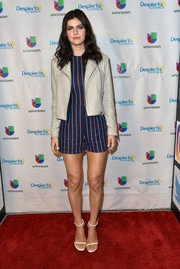 Alexandra Daddario topped off her romper with a chic beige leather jacket.
