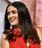 Salma Hayek sported a center-parted style with flippy ends when she visited 'Despierta America.'