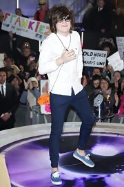 Frankie Cocozza stuck to his signature look with a button-down shirt, skinnies and, of course, a pair of canvas kicks.