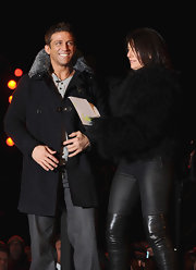 Davina McCall looked over-the-top in her black fur coat and thigh-high boots on the set of 'Celebrity Big Brother.'