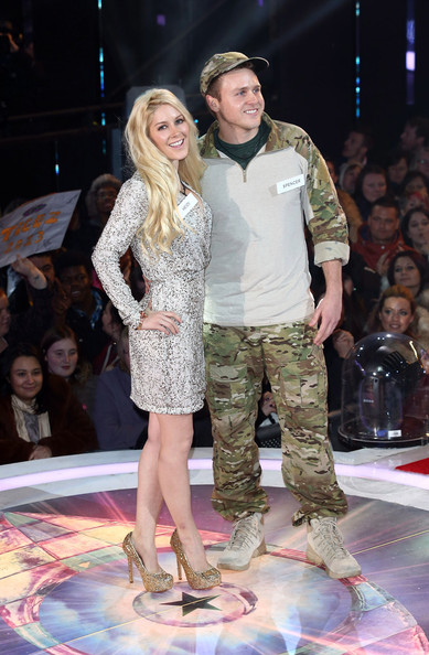 Heidi Montag posed for photos in a pair of glittery gold pumps.