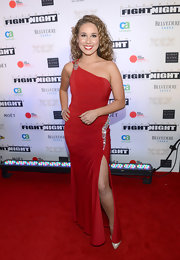 Haley Reinhart chose a vibrant red, one-shouldered dress with silver gem embellishments for her red carpet look.