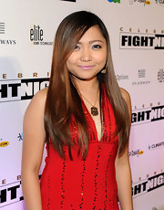 Charice accessorized a red evening gown with a gold dog tag necklace.