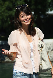 Alessandra Mastronardi kept it casual and sweet in a puff-sleeve pink blouse over a white tank.