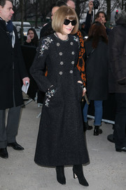 Anna Wintour hit Paris Fashion Week wearing a vintage-glam charcoal coat with flower buttons and embroidered shoulders.