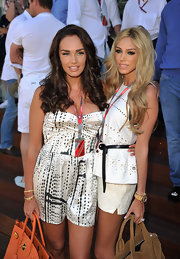 Billionaire Petra Ecclestone wore her hair in long wavy tresses for the Grand Prix.