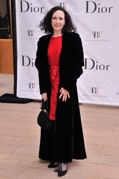 Bebe chose looked classically elegant with a floor-length black wool coat paired over a ruby red cocktail dress.