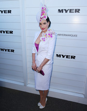 Dita Von Teese looked flawlessly styled, as always, in an orchid-embellished white skirt suit by Aurelio Costarella and a matching headpiece during Melbourne Cup Day.