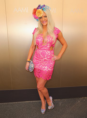 Brynne Edelsten was a sexy head turner in a neon-pink lace-overlay cutout dress with a cleavage-baring neckline during Melbourne Cup Day.