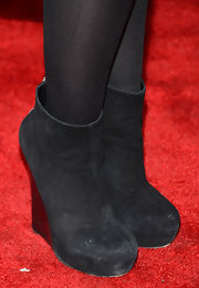 Hayley Hasselhoff chose black suede ankle booties with wedge heels for her red carpet look.