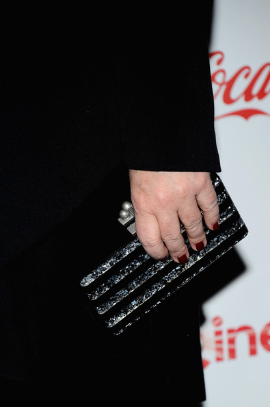 Melissa McCarthy chose a silver striped clutch to give her monochromatic look a touch of metal.