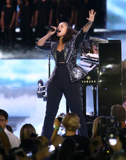 Alicia Keys cut a strong figure in a fitted black jacket with silver embellishments while performing during WE Day California.