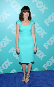 Alexis chose a bright summery frock in a teal color for her look at the FOX programming party.