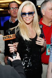 Jenny McCarthy was true blue at the SiriusXM studios in a pair of cobalt wayfarers.