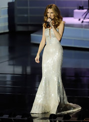 Celine shined in a strapless curve-hugging gown with large clear paillettes on stage in Las Vegas.