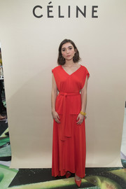 Rowan Blanchard complemented her dress with a pair of red pumps.