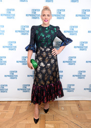 Busy Philipps completed her vibrant look with a green hard-case clutch by Jeffrey Levinson.