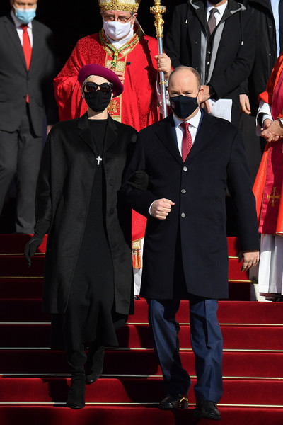 Charlene Wittstock kept it minimal in a black coat layered over a matching dress at the ceremony of the Sainte-Devote in Monaco.