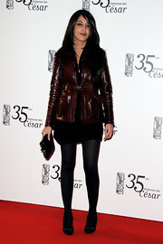 Leila Bekhti added some attitude to her look with a burgundy leather jacket at the Cesar Film Awards.