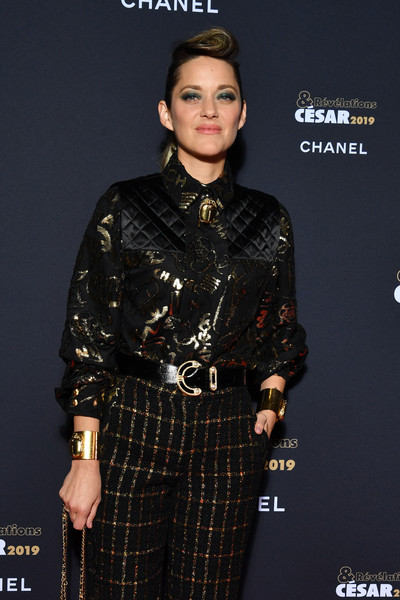 Marion Cotillard rocked gold cuff bracelets on both wrists at the Cesar Revelations 2019.