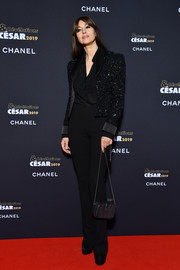 Monica Bellucci finished off her menswear-inspired outfit with a pair of black trousers.