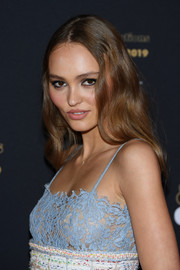 Lily-Rose Depp sported barely-there waves at the Cesar Revelations 2019.