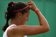 Laura Robson keeps her hair braided and away from her face with these pink ponytail holders.