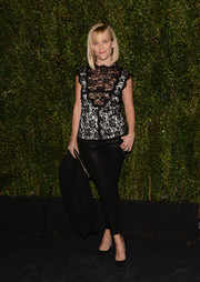 Reese Witherspoon paired her lace top with black leather skinnies by J Brand for a bit of edginess.